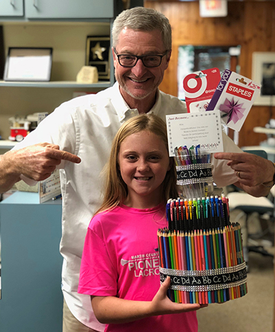 July contest winner Ella with Dr. Lively,